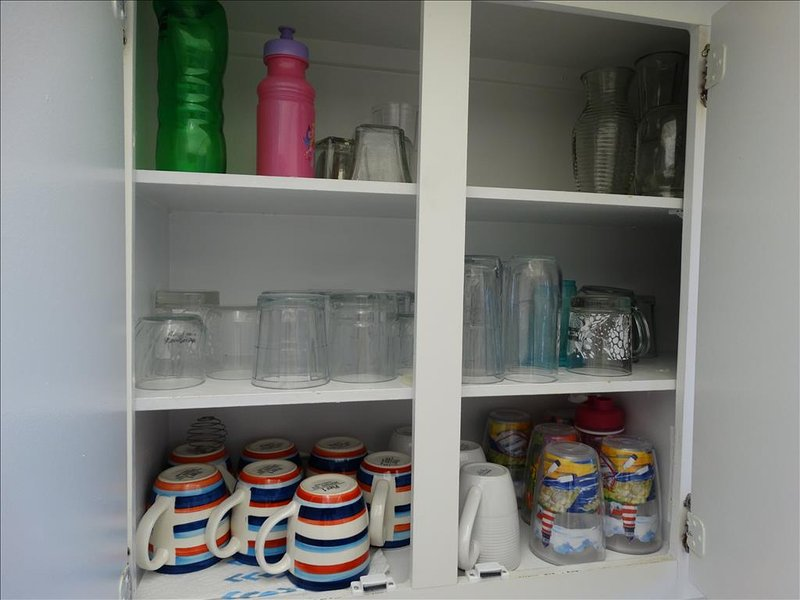 Cups, Glasses, and MORE adorn the cupboards here at your Canaveral Beach 402!