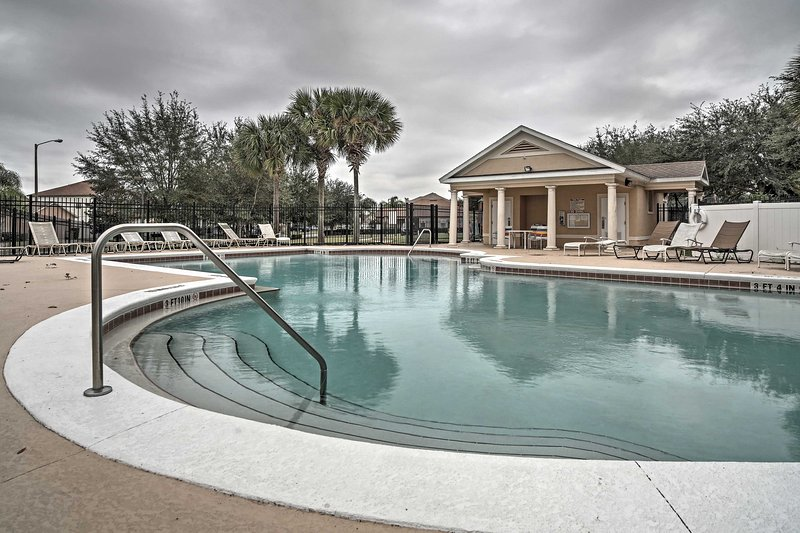 Take advantage of the phenomenal amenities offered by this Clermont vacation rental, like this community pool! The home also features its own private pool.