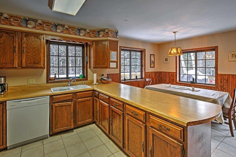 Preparar uma refeição caseira na cozinha totalmente equipada.