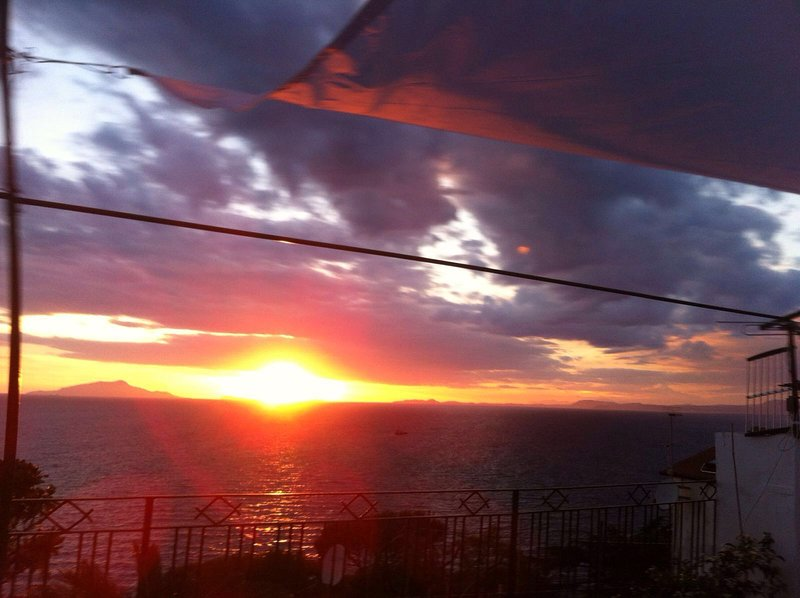 sunset over the sea and the island of Ischia, from the house terrace