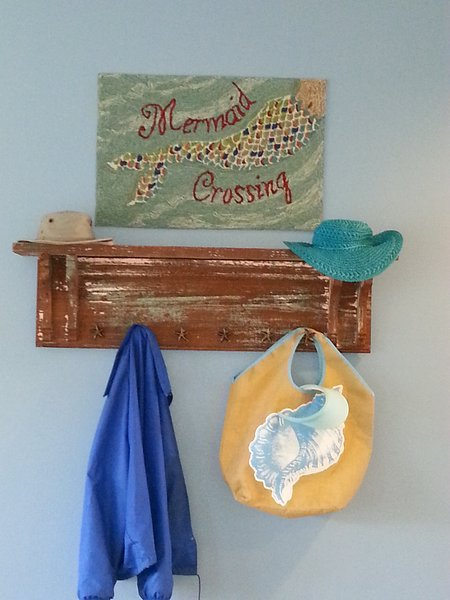 Welcoming hat/coat rack...our signature 'Mermaid Crossing'
