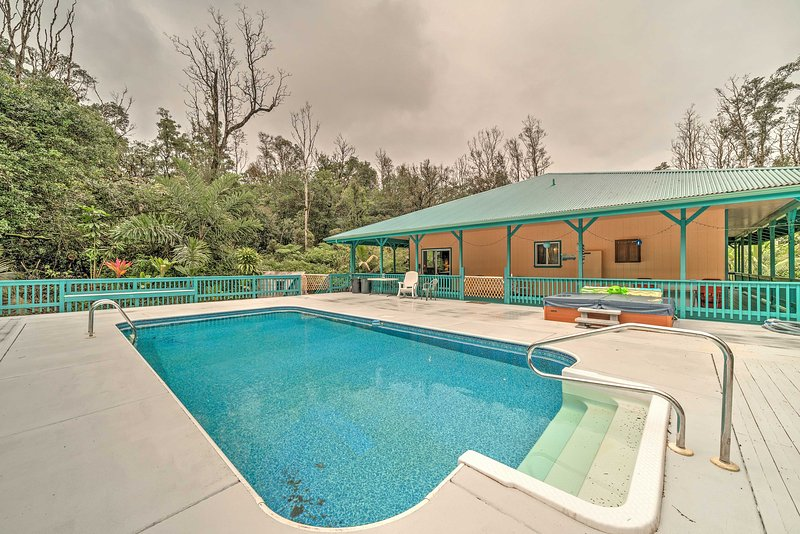 Featuring a private pool and hot tub on a secluded, beautifully landscaped acre, this vacation rental home promises a rejuvenating retreat.