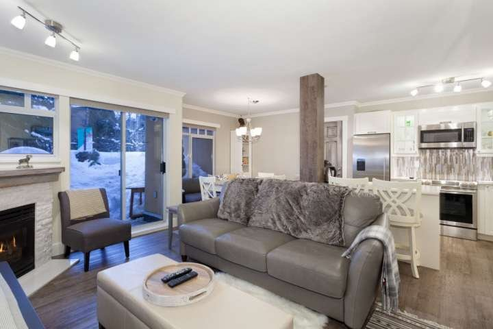 Stunning exquisite living room, leather queen sofa, gas fireplace