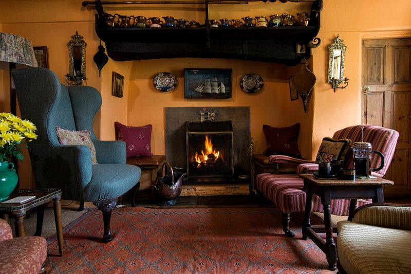 The cosy Living Room is perfect for pre-dinner drinks or to relax with a book