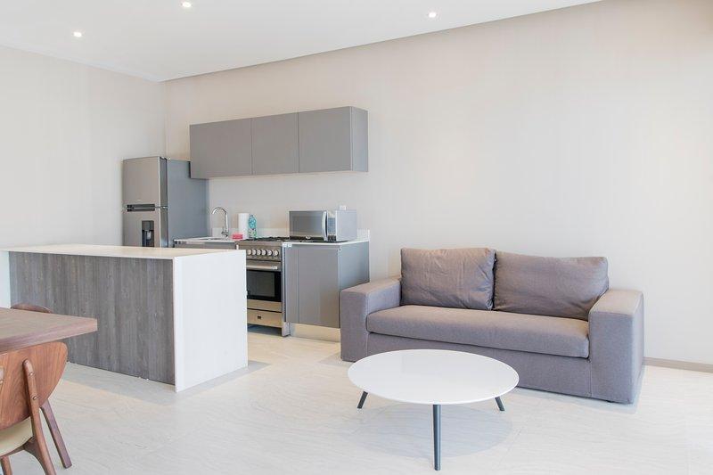 Modern 1-bedroom Apartment in Guadalajara, alquiler de vacaciones en Zapopan