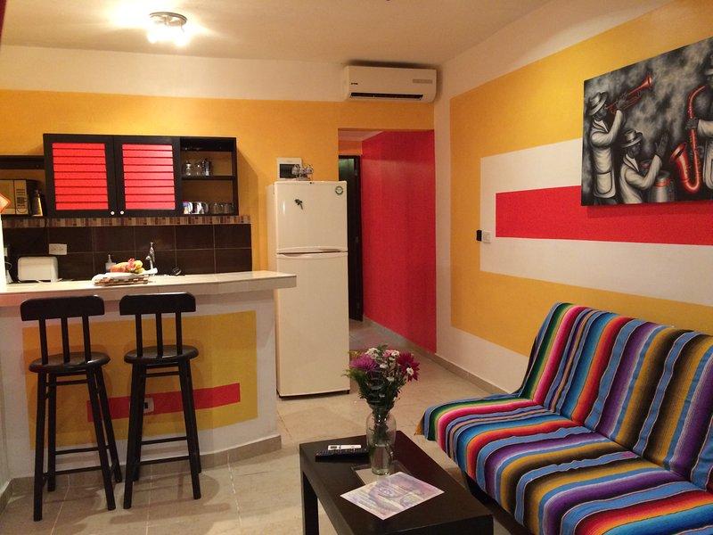 sala de estar y una visión general de la cocina Viva Maria