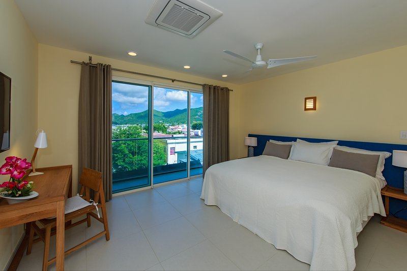 Second bedroom has its own small terrace with a view of the lagoon and hills