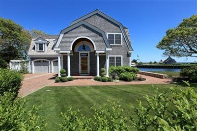 A one-of-a-kind masterpiece waterfront property in Harwich Port -- THAT'S the way to spend your summer vacation!