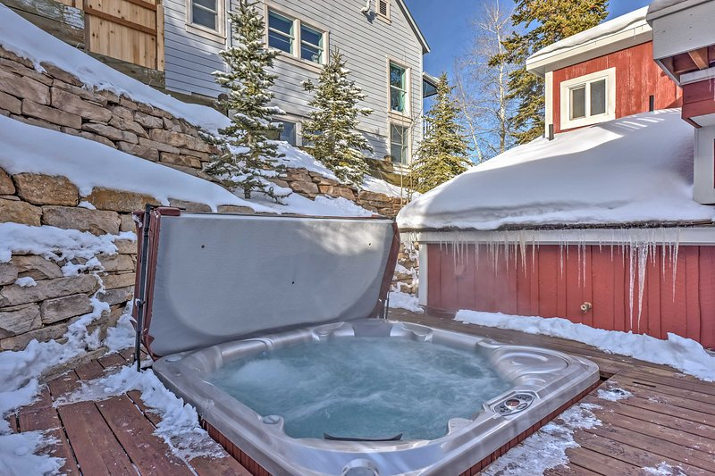 This home is fully renovated boasting a fireplace, gourmet kitchen, and hot tub!