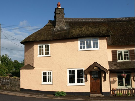 Crown Cottage in a village setting.