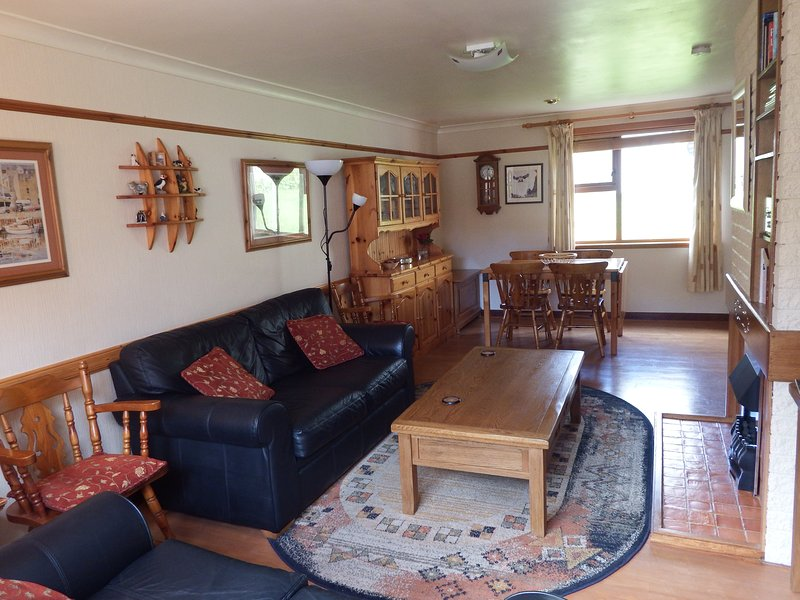 Lounge with adjacent dining area