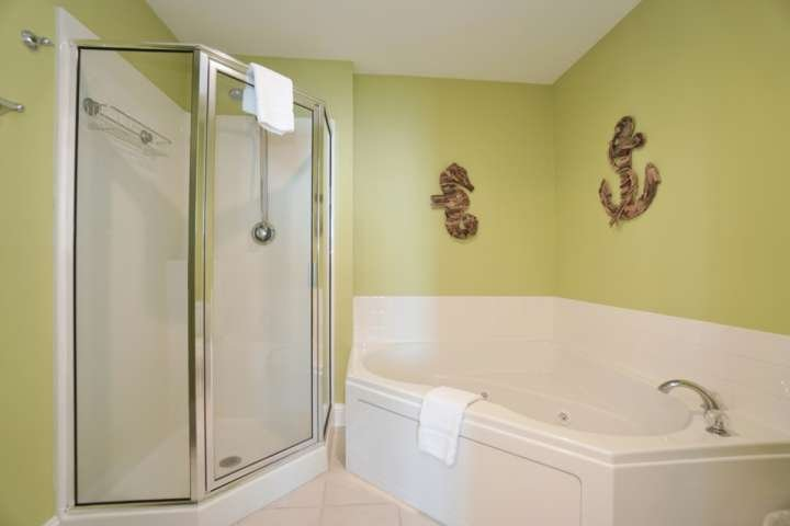 Master bath with whirlpool tub and walk-in shower