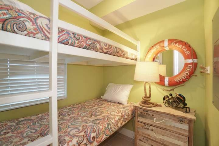 Bonus room with twin bunk beds and dresser