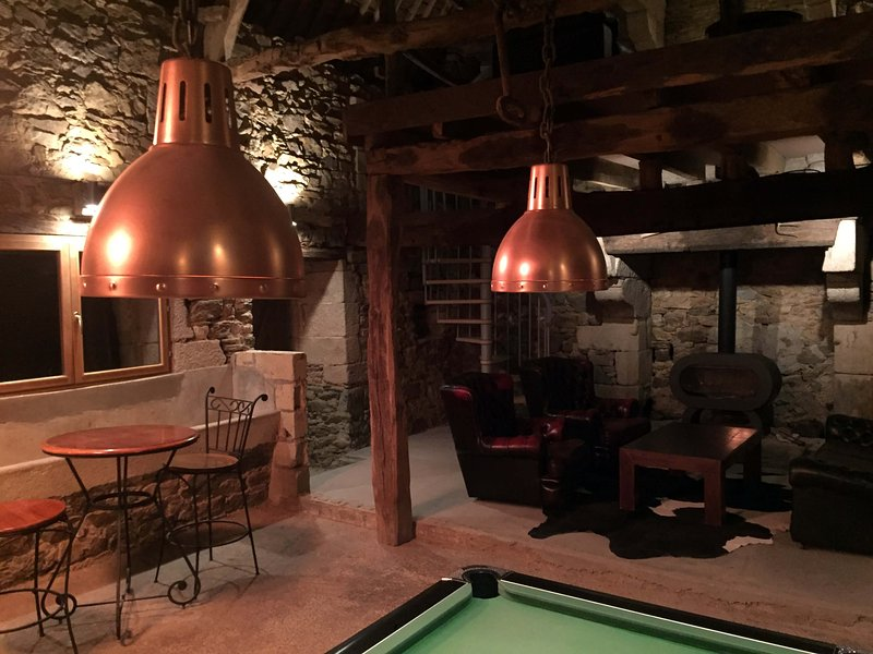 copper lighting and bar seating plus cosy corner by the fire