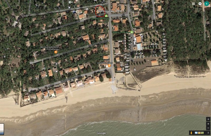 Satellite view of housing and access to beach
