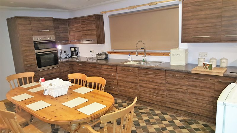 Spacious cosy fully kitted kitchen with large Pine Table