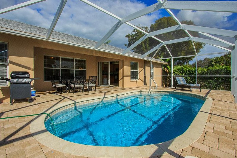 Pool with BBQ Grill and Outdoor Dining Table
