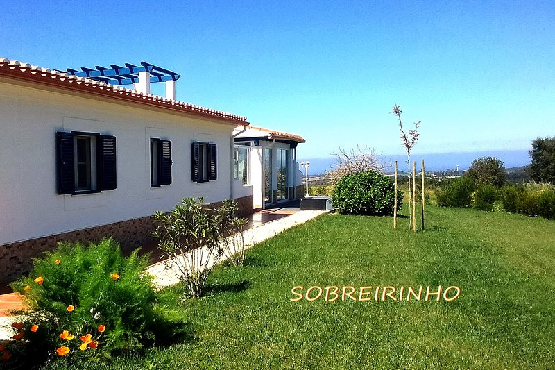 Large family house with sea view and private lawn area