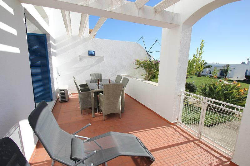 private terrace leading to pool and gardens