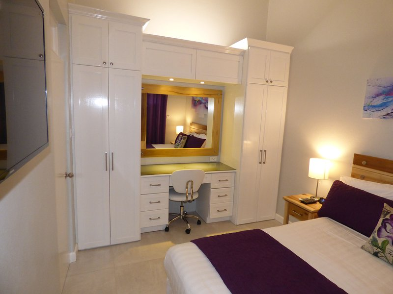 Beautiful Modern Bedroom with 50inch flat screen and Desk with USB plugs.