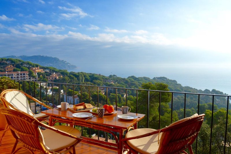 Start the day with breakfast and a fantastiv view over Calella and the sea.