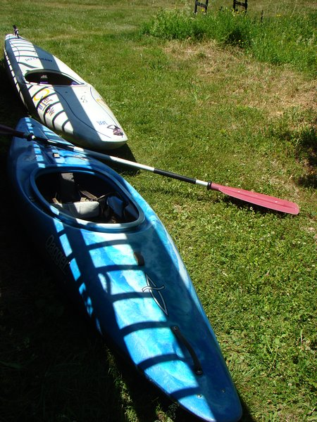 kayaks and inner tubes available to use on pond