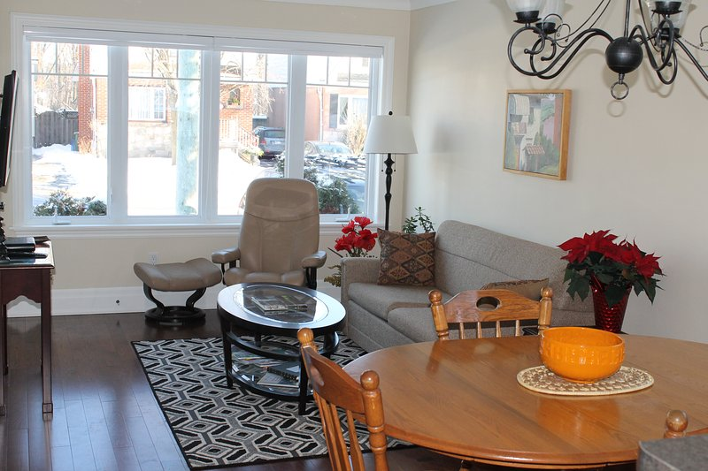 The open concept living room dining room kitchen is sunny and bright