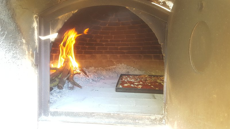 Big wood oven , where you can cook the pizza !!