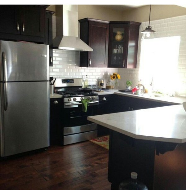 The kitchen offers microwave, gas stove, beautiful island.