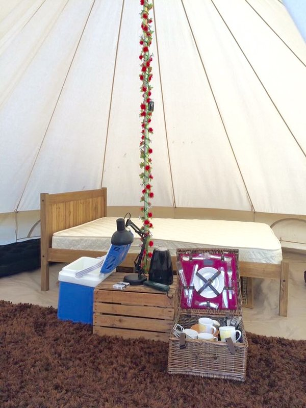 Inside Bell Tent - pine double Bed plus single air matrresses