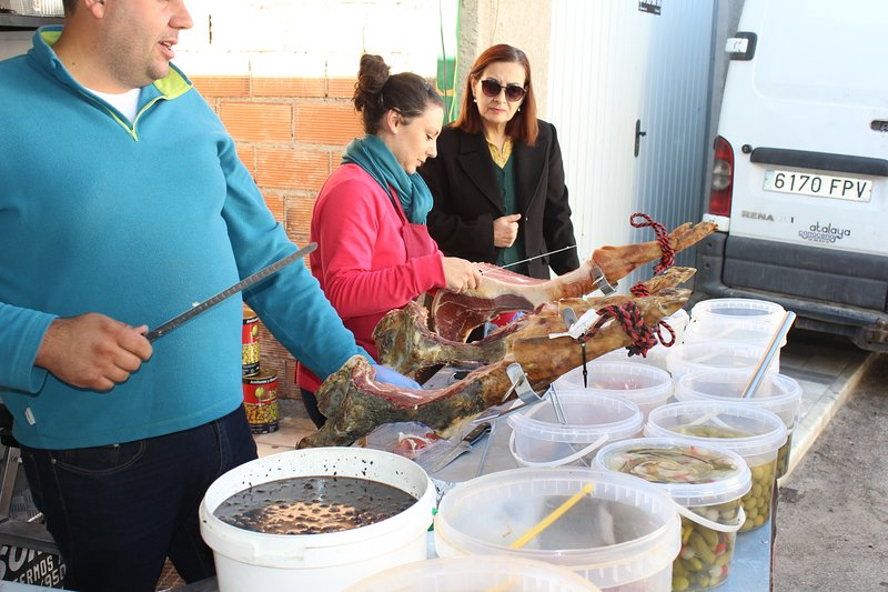 Iberico ham carvers in Olula del Rio weekly market