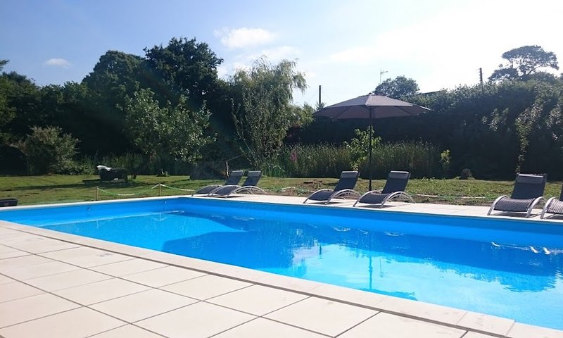 Relax by our 10m x 5m outdoor heated swimming pool (shared)