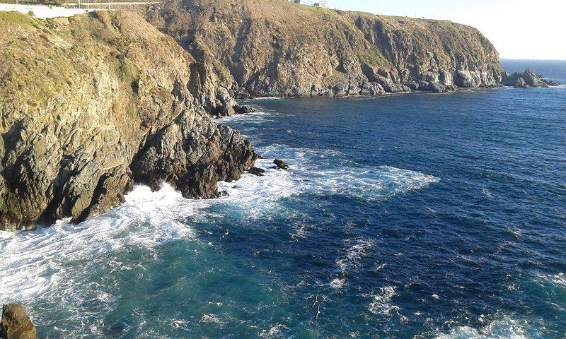 Beach, view towards the cliffs viewpoints