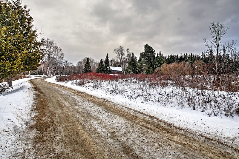 The cabin is secluded on a quiet road.