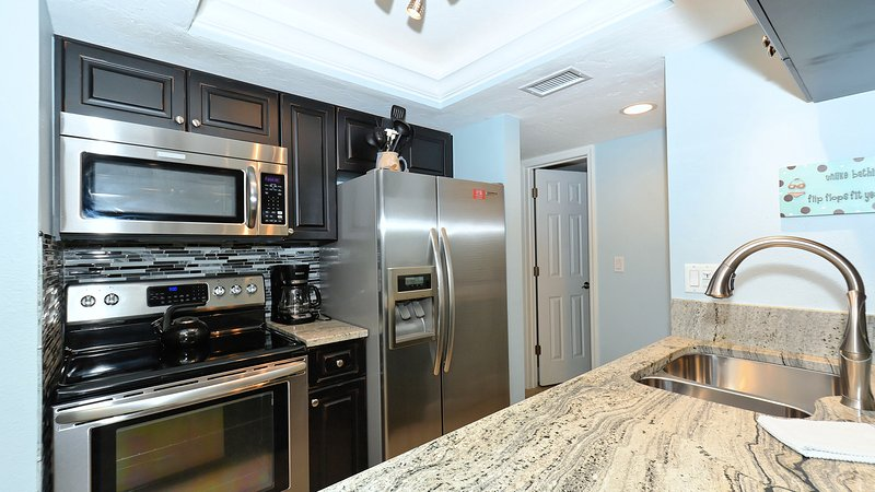 New Kitchen with high-end appliances! Granite and custom cabinets.