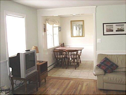 Upstairs, living room toward kitchen area