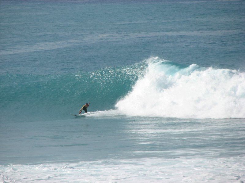 Surfer from Lanai. Unbeatable coastline  views for any price. with best break on island.