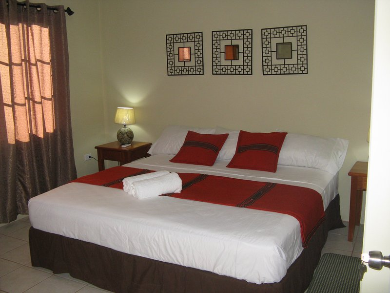 King size bed in room with A.C.