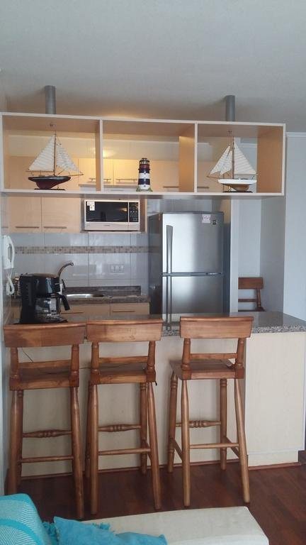 View kitchenette with dining