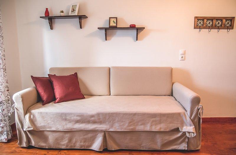 sofá-cama na sala do 1º andar