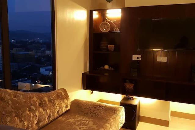 Wall TV and lounge chair