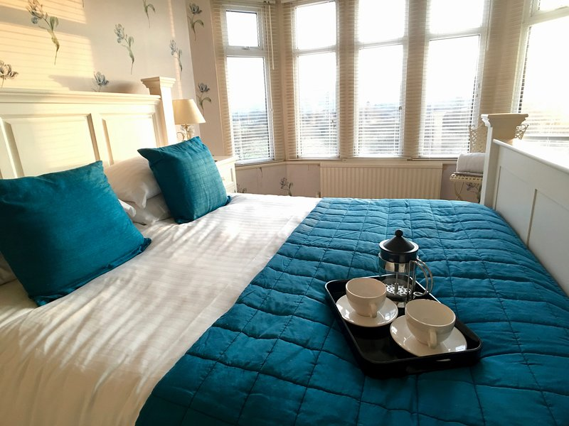 Master bedroom - enjoy breakfast in the kingsize bed.