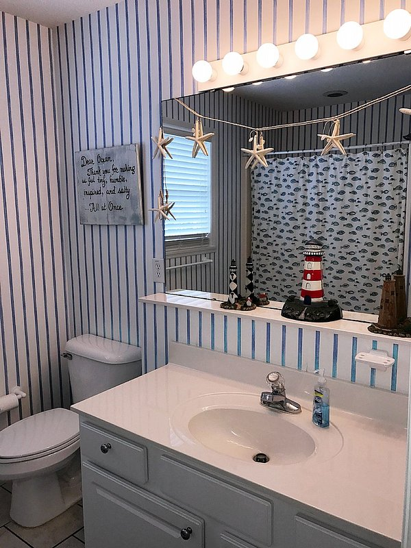 bathroom on living level open to hallway