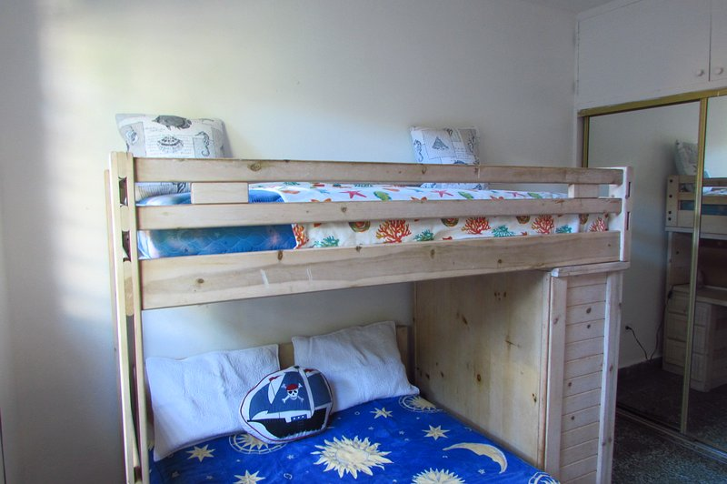First bedroom with bunk bed, full size and twin size.