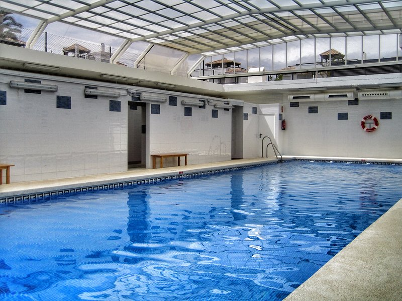 heated pool equipped with changing rooms and toilets