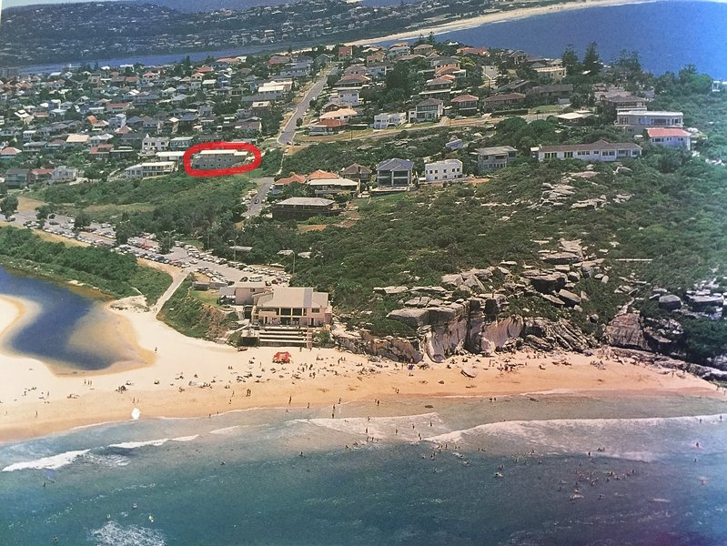 View from beach, house circled in red