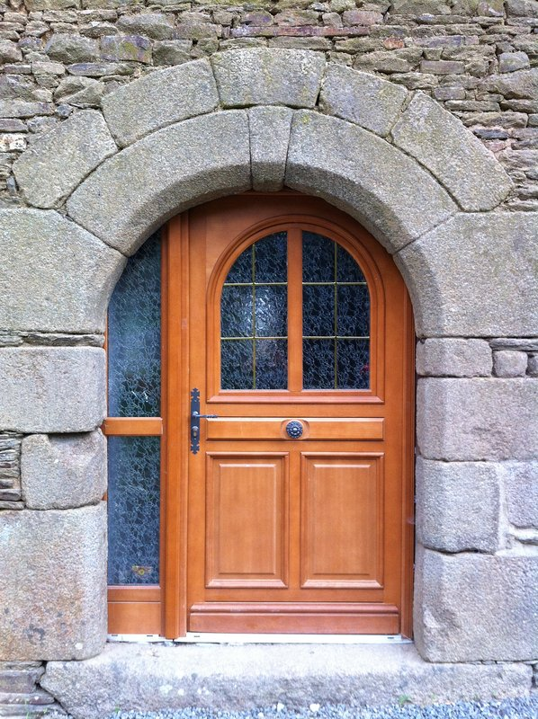 Arched stone entrance to house