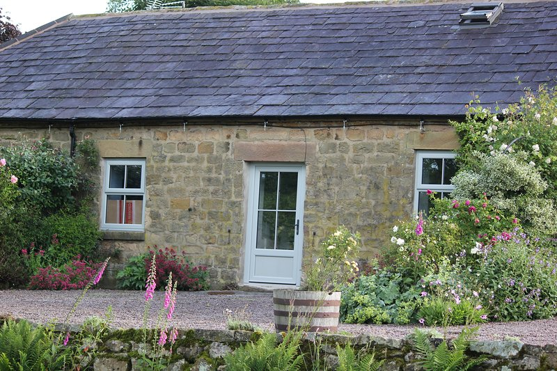 Dovedale Cottage with terrace overlooking gardens