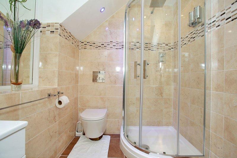 Gedeelde badkamer op de 1e verdieping