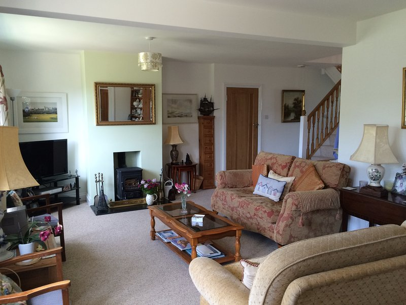 Cosy living room with log burner.